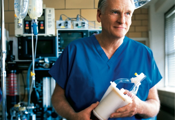 Dr. Robert Bartlett holds ECMO medical device