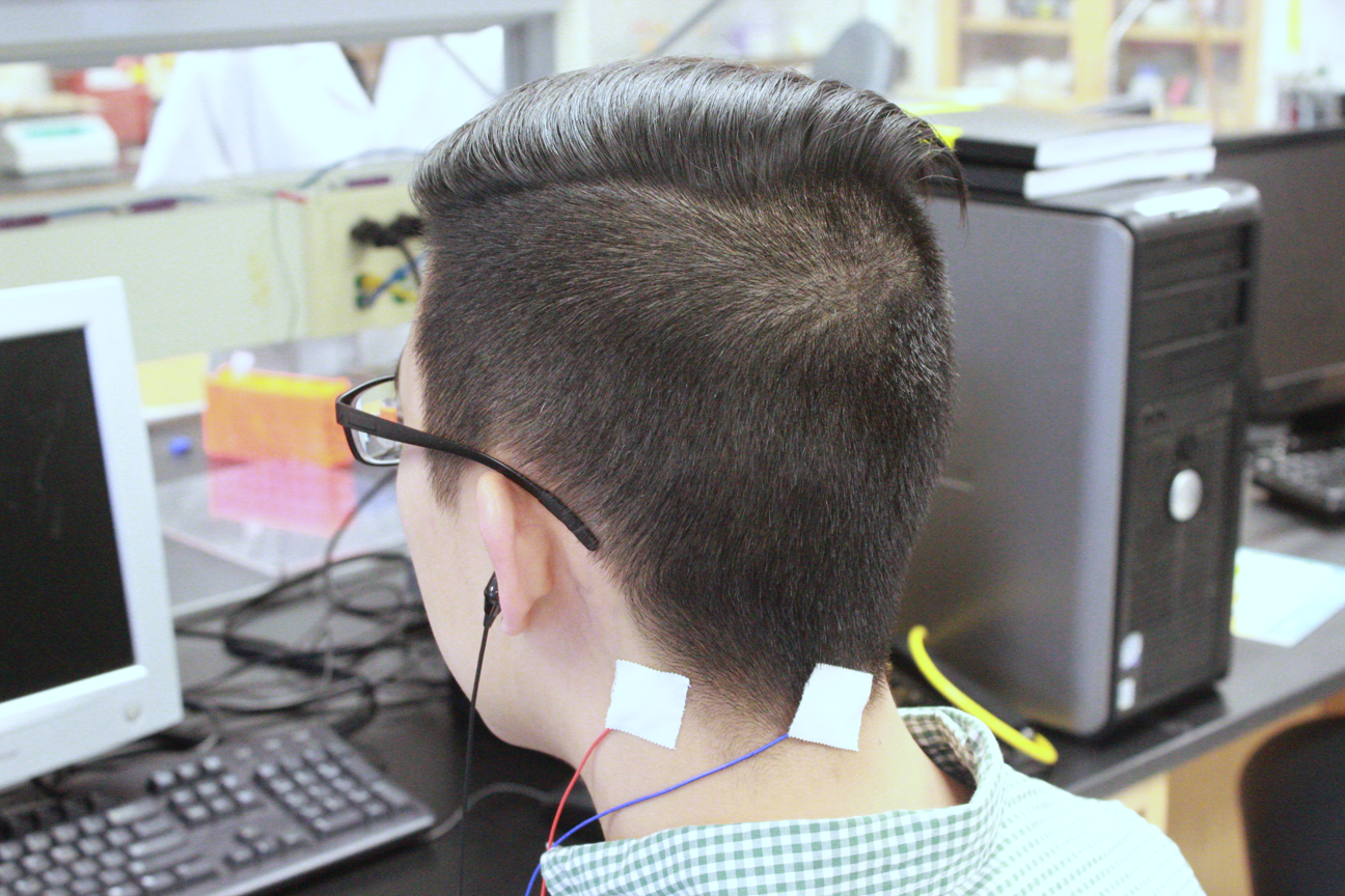 Researcher wearing tinnitus device