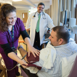 Male patient receives care in the BMT Adult Clinic